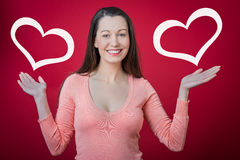 Valentine's day surprise!. Young happy smiling woman with heart symbol. Valentine's day surprise Royalty Free Stock Images