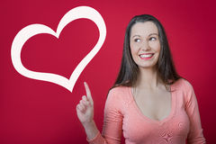 Valentine's day surprise!. Young happy smiling woman with heart symbol. Valentine's day surprise stock photography