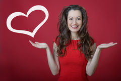 Valentine's day surprise!. Young happy smiling woman with heart symbol. Valentine's day surprise stock photos