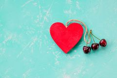 Valentine`s Day, surprise gift with red Cherry. Healthy food.Red berry cherries,wooden heart. SUMMER love, Still life on. Valentine`s Day, surprise gift box with royalty free stock images