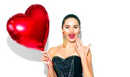Valentine`s Day. Surprised beauty girl with red heart shaped air balloon Royalty Free Stock Images