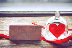 Valentine`s Day sweet heart in a glass jar under a cap Royalty Free Stock Images