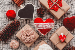 Valentine's Day symbols - hearts, presents in craft paper Stock Photos