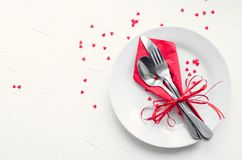 Valentine`s Day tabble setting with cutlery stock image