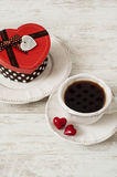 Valentines day tea set with cup of coffee and gift. Valentine or birthday celebration tea set with cup of coffee, gift box and couple red hearts Stock Photo