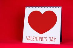Valentine`s day text and heart in office planner Stock Photo