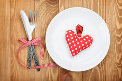 Valentine's Day toy heart over plate with silverware Royalty Free Stock Photos