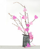 Valentine's Day. Valentine tree made out of bare twigs and paper cutout pink hearts in a vintage tin pitcher stock photography