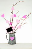 Valentine's Day. Valentine tree made out of bare twigs and paper cutout pink hearts in a vintage tin pitcher royalty free stock photography
