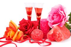 Valentine`s day. Two glasses, candles and roses  isolated on white background Stock Image