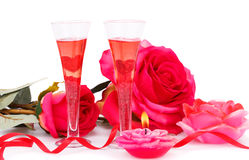 Valentine's day. Two glasses, candles and roses  isolated on white background Royalty Free Stock Images