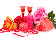 Valentine's day. Two glasses, candles and roses  isolated on white background Stock Photography