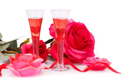 Valentine`s day. Two glasses, candles and roses  isolated on white background Royalty Free Stock Photo