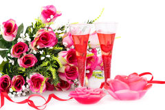 Valentine`s day. Two glasses, candles and roses  isolated on white background Royalty Free Stock Image