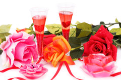 Valentine`s day. Two glasses, candles and roses  isolated on white background Stock Images