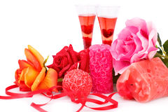 Valentine`s day. Two glasses, candles and roses   on white background Royalty Free Stock Images