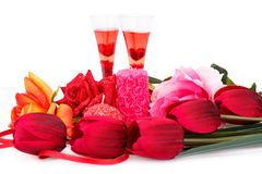 Valentine`s day. Two glasses, candles, tulips and roses  isolated on white background Stock Photo