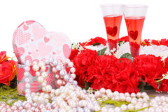 Valentine's day. Two glasses, flowers, colorful pearls necklaces and gift box on white background Royalty Free Stock Photos