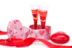 Valentine's day. Two glasses with red candle, gift box and red ribbon isolated on white background Stock Images