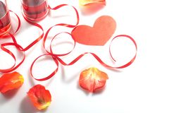 Valentine`s Day. Two glasses with red wine and gifts Royalty Free Stock Image