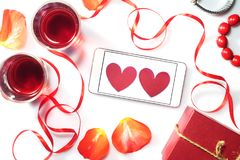 Valentine`s Day. Two glasses with red wine and gifts. Top view Royalty Free Stock Photo