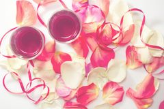 Valentine`s Day. Two glasses with red wine and gifts. Top view Stock Photos