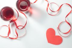 Valentine`s Day. Two glasses with red wine and gifts. Top view Royalty Free Stock Images