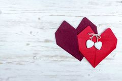 Valentine`s Day. two hearts of red napkins.  royalty free stock images