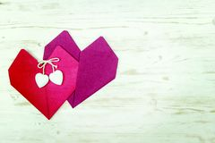 Valentine`s Day. two hearts of red napkins.  royalty free stock image