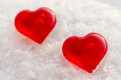 Valentine`s day two hearts in winter in the snow. Valentine`s day love two red hearts on snow in winter Stock Photo
