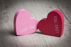 Valentine`s day - Two hearts on wood. Stock photo stock photography