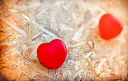 Valentine's Day. Two hearts on wooden background stock images