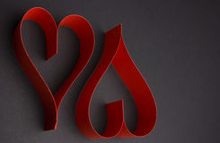 Valentine`s Day two red hearts. On black background Royalty Free Stock Photography