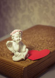 Valentine's Day. Vintage angel and heart Royalty Free Stock Photos