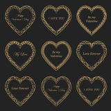 Valentine`s Day vintage frames on background. Valentine`s Day vintage gold frames on black background Royalty Free Stock Images