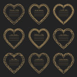 Valentine`s Day vintage frames on background. Valentine`s Day vintage gold frames on black background Stock Photo