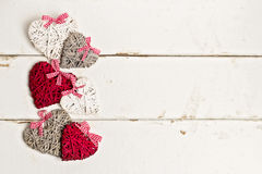 Valentine's day. Vintage style.  Hearts on old white wooden back Royalty Free Stock Photo