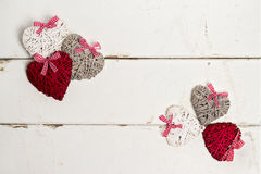 Valentine's day. Vintage style.  Hearts on old white wooden back Stock Image
