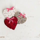 Valentine's day. Vintage style. Three hearts on old white wooden Royalty Free Stock Images
