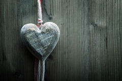 Valentine's Day wallpaper - Big Wood heart on wood background Royalty Free Stock Photography