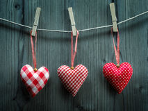 Valentine's Day wallpaper - Textile hearts hanging on the rope Stock Photography