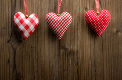 Valentine's Day wallpaper - Textile hearts hanging on the rope Royalty Free Stock Photography