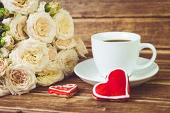 Free Valentine`s Day. Wedding . A Cup Of Coffee And Two Gingerbread Heart On A Background Of Roses Royalty Free Stock Photography - 106409097