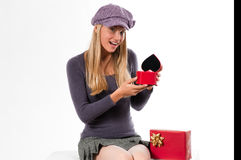 Valentine's Day or Wedding Anniversary. Beautiful young woman receiving a heart shaped box for Valentine's Day or Wedding Anniversary Stock Images