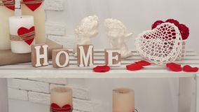 Valentine`s Day, Wedding footage of two angels and candles with hearts on a shelf. stock video footage