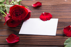 Valentine's Day: White empty paper card and roses Stock Photo
