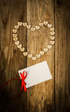 Valentine`s day. On the White Isolated Letter and Нeart from buttons on a wooden background. Valentine`s day Royalty Free Stock Photography