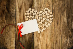 Valentine`s day. On the White Isolated Letter and Нeart from buttons on a wooden background. Valentine`s day Stock Images