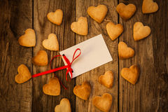 Valentine`s day. On the White Isolated Letter and Gingerbread Cookies in the Shape of Heart at Valentine Day. On the wooden background Royalty Free Stock Photos