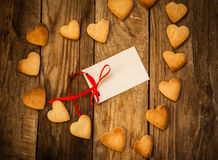 Valentine`s day. On the White Isolated Letter and Gingerbread Cookies in the Shape of Heart at Valentine Day. On the wooden background Stock Photography